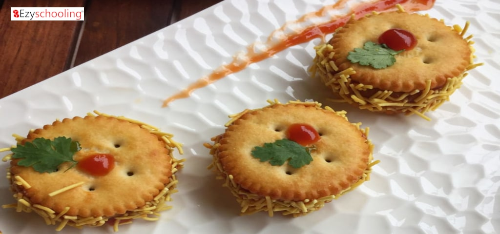 Stuffed Sev Puri in Monaco biscuits.