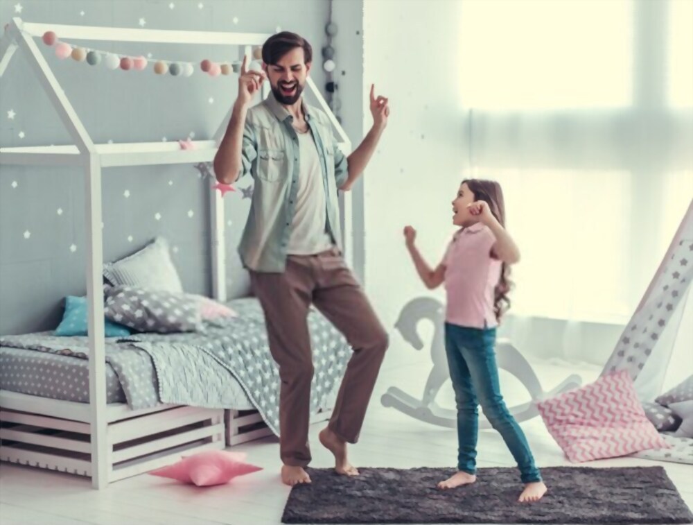 Father dancing with daughter