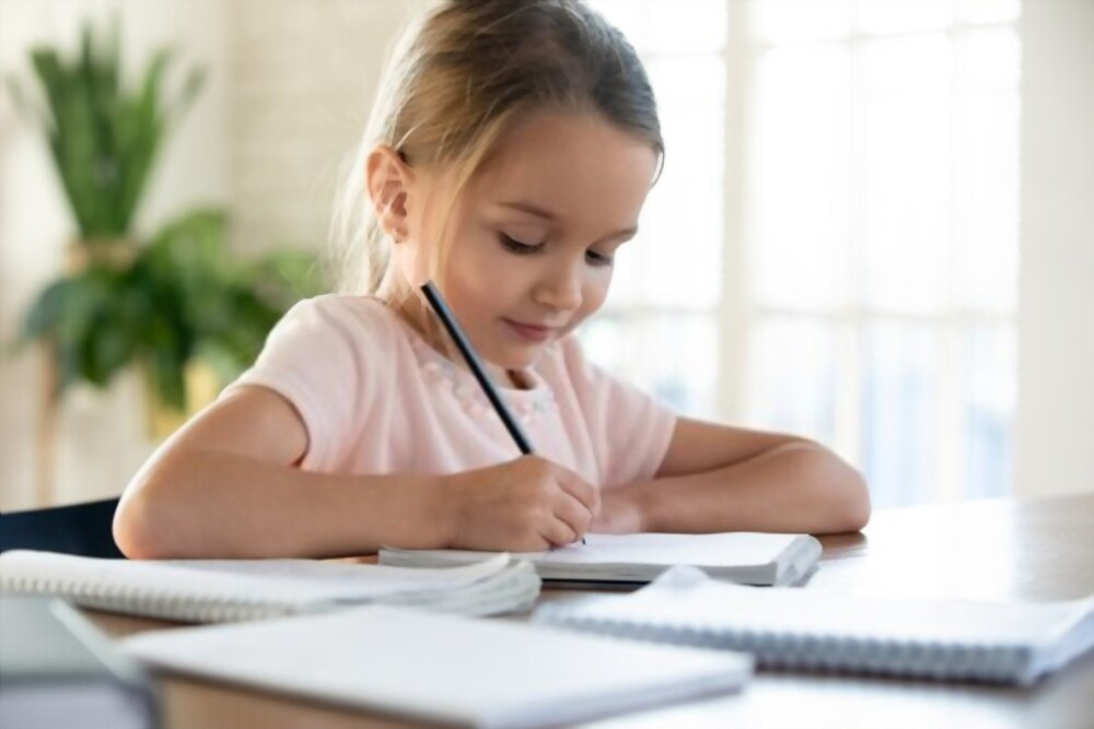 Child gripping a pencil