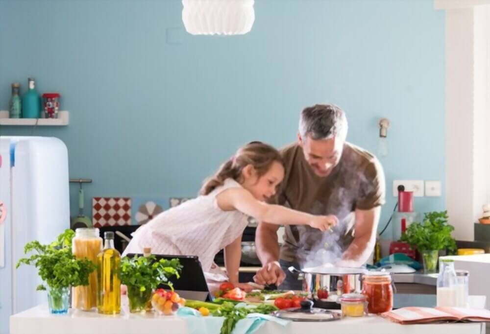 kids enjoying cooking with dad